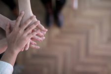 crop-group-stacking-hands-together-3830745
